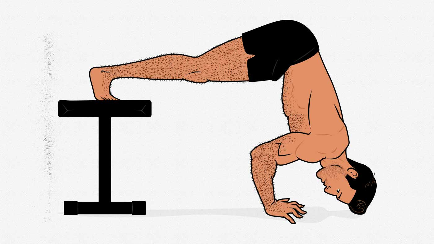 Illustration of a man doing a pike push-up with his feet raised.
